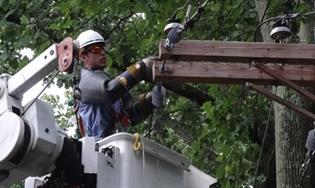 men fixing power lines